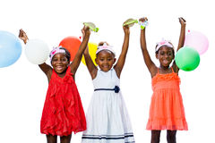 Threesome african girls playing with balloons. Close up portrait of cheerful threesome African youngsters holding colorful balloons.Isolated against white Stock Photo
