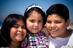 Threesome Hispanic Family. A hispanic family takes a shot together at the beach Royalty Free Stock Photography