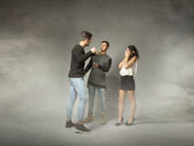 Threesome problems. People emotions and expressions in dark background Stock Image