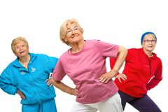 Threesome senior women getting fit. Threesome group of senior women doing stretching exercise.Isolated on white Royalty Free Stock Photography