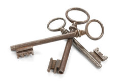 Threesome Of Skeleton Keys. Three old skeleton keys,  on white with soft shadows. Clipping path included Royalty Free Stock Images