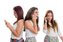 Threesome teen girls talking on smart phones. Portrait of Threesome teen girls talking on smart phones.Isolated on white background Royalty Free Stock Image