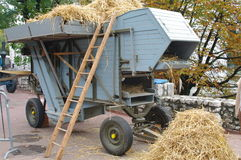 Threshing machine. Blue threshing machine during a rural exhibition in annecy in french alps Royalty Free Stock Photo