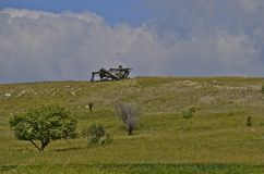 Threshing machine on hilltop Stock Photos