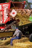 Threshing Machine. An old fashioned threshing machine is operated by a farmer at the Border Union Agricultural Show in Kelso, Scotland Royalty Free Stock Photos