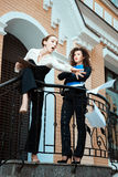 On the threshold office, there are two women. Stock Photo