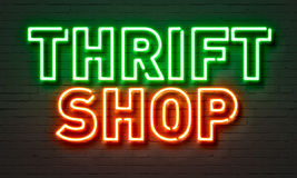 Thrift shop neon sign on brick wall background. Thrift shop neon sign on brick wall background Stock Image