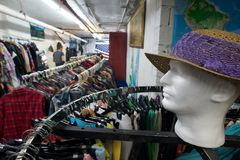 Thrift store. Clothes racks in a thrift store basement Stock Photos