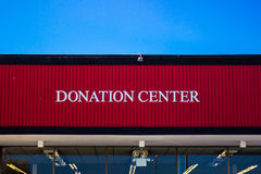 Thrift Store Donation Center Sign. On Top of Building Royalty Free Stock Image