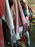 Thrift store. Racks of garments in a thrift store Stock Images