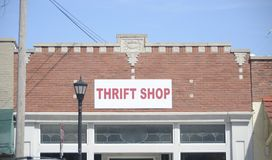 Thrift Store and Consignment Shop. A thrift store sells donated items and second-hand clothes, shoes, household items and furniture Royalty Free Stock Images