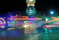 Thrill Ride. At a funfair at night, motion blur stock photography