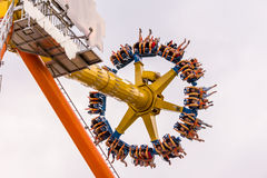 Thrill ride spinning in the air Stock Photo