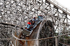 Thrill ride with wooden coaster Royalty Free Stock Photo