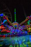 THRILL RIDES WITH COLORFUL LIGHTS Royalty Free Stock Images
