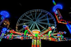 THRILL RIDES WITH COLORFUL LIGHTS Stock Image