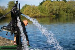 Thriller seeker`s jet pack for jet lev or jet levitation waits by the lakeside. Royalty Free Stock Photo