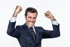 Thrilled corporate man with elegant suit for success and joy Stock Photography