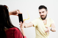Thrilled couple taking mobile photographs and selfies Royalty Free Stock Image