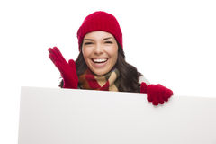 Thrilled Girl Wearing Winter Hat and Gloves Holds Blank Sign Royalty Free Stock Photo