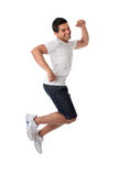 Thrilled man jumping for joy. A thrilled excited man jumping into the air.   Jump for Joy.  Guy success or victory leap.  White background Stock Photo
