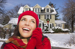 Thrilled Mixed Race Woman in Winter Clothing Outside in Snow Royalty Free Stock Photo