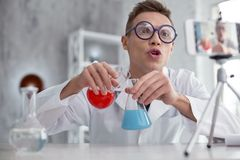 Thrilled popular blogger conducting a new experiment Stock Image