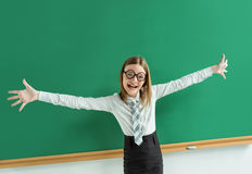 Thrilled pupil raise her palms up. Royalty Free Stock Image