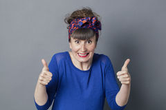 Thrilled retro 30s woman with thumbs up for exciting success Royalty Free Stock Photography