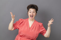 Thrilled 20s fat woman expressing fun victory Stock Photos