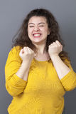 Thrilled 20s fat woman expressing joy and amazement Royalty Free Stock Photos