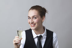 Thrilled 20s girl holding glass of bubbly wine at party to celebrate success at becoming sommelier Stock Photos