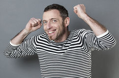 Thrilled 40s man expressing joy and success Royalty Free Stock Photos