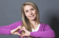 Thrilled 20s woman showing heart shape with hands Royalty Free Stock Photos