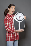 Thrilled 30s woman taking care of her health with weight control Stock Photos