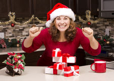 Thrilled woman during Christmas Stock Images