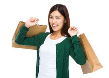 Thrilled woman with shopping bag Royalty Free Stock Photography