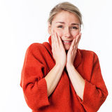 Thrilled woman touching her face for wellbeing and pleasure Stock Image