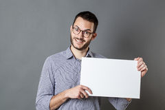 Thrilled young businessman holding banner for copy space text Stock Image