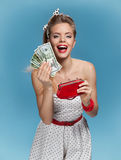 Thrilled young lady holding cash and happy smiling. Shopping concept Stock Photos