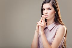 Thrilled young woman making hand gun sign with fingers for sexy business fight Stock Photo