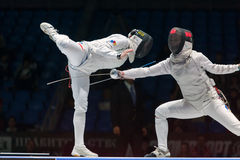 Thrilling battle on championship of world in fencing Royalty Free Stock Photography
