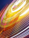 Thrills. A carnival thrill ride flashing at night stock photography