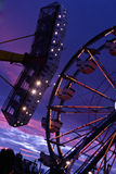 Thrills. Carnival rides flashing at night stock photos