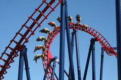 Thrills. A twisting and turning rollercoaster stock images