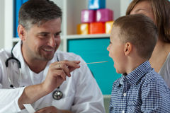 Throat examination at pediatrician's office Stock Photo
