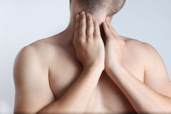 Throat pain. Acute pain in a throat at the young men Royalty Free Stock Images