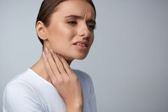 Throat Pain. Beautiful Woman Having Sore Throat, Painful Feeling Stock Photo