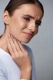 Throat Pain. Beautiful Woman Having Sore Throat, Painful Feeling Stock Photos