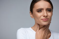 Throat Pain. Beautiful Woman Having Sore Throat, Painful Feeling. Throat Pain. Beautiful Woman Having Sore Throat, Feeling Sick. Unhappy Ill Female Suffering Royalty Free Stock Images